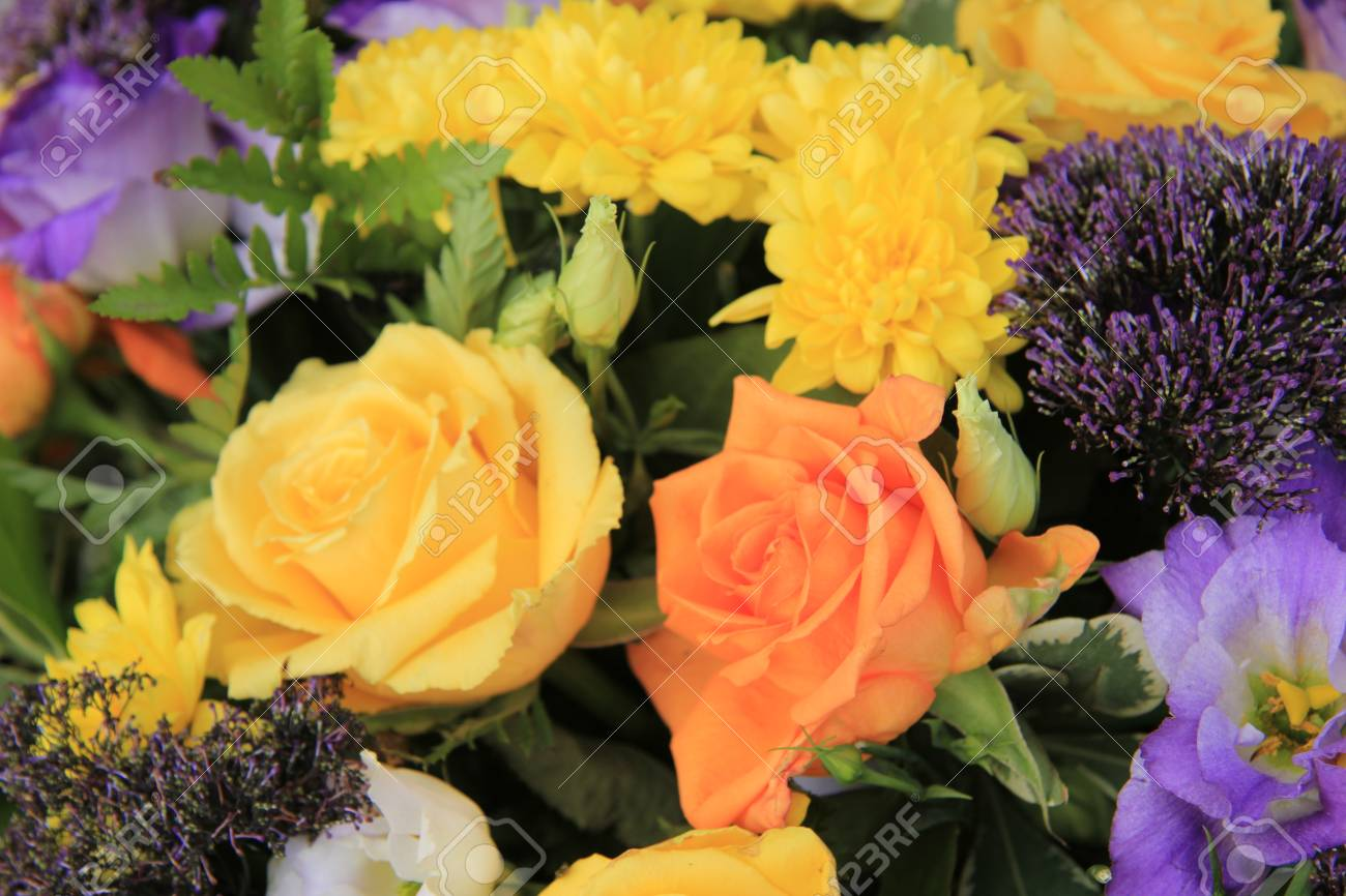 Mixed Flower Arrangement Various Flowers In Yellow Orange And