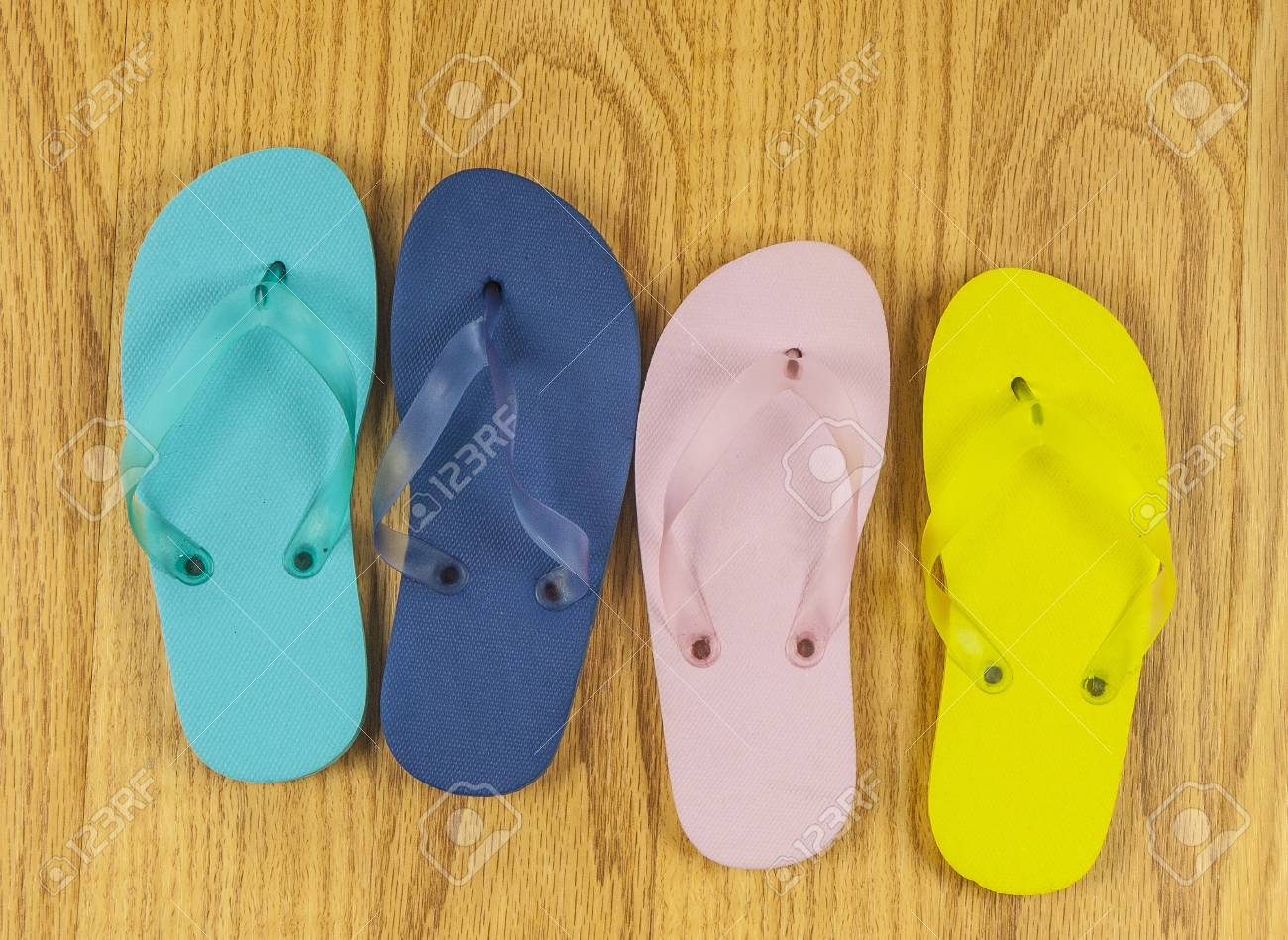 327c0d07920b5 Stock Photo - Thong sandals on wood floor