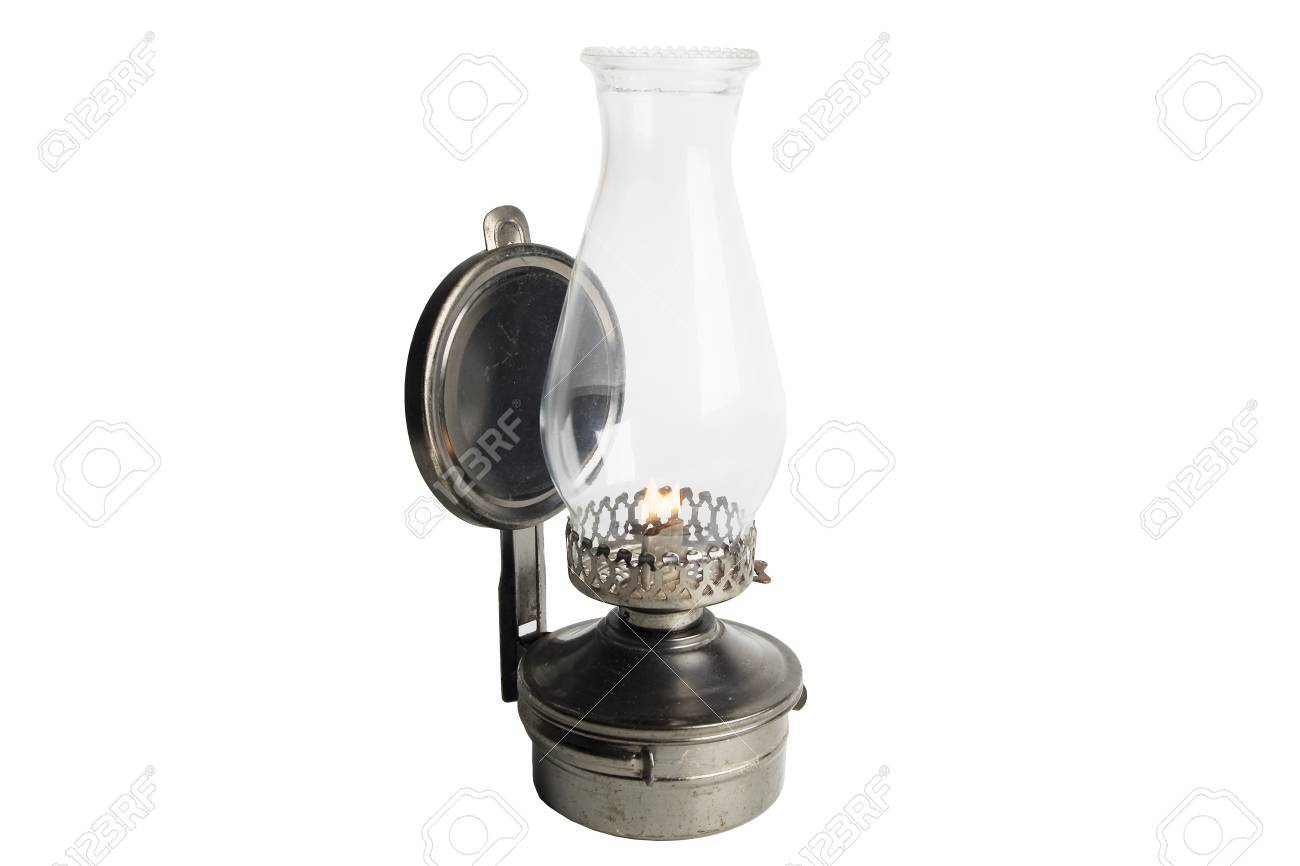 Lit Antique oil lamp isolated on white Stock Photo - 14812946