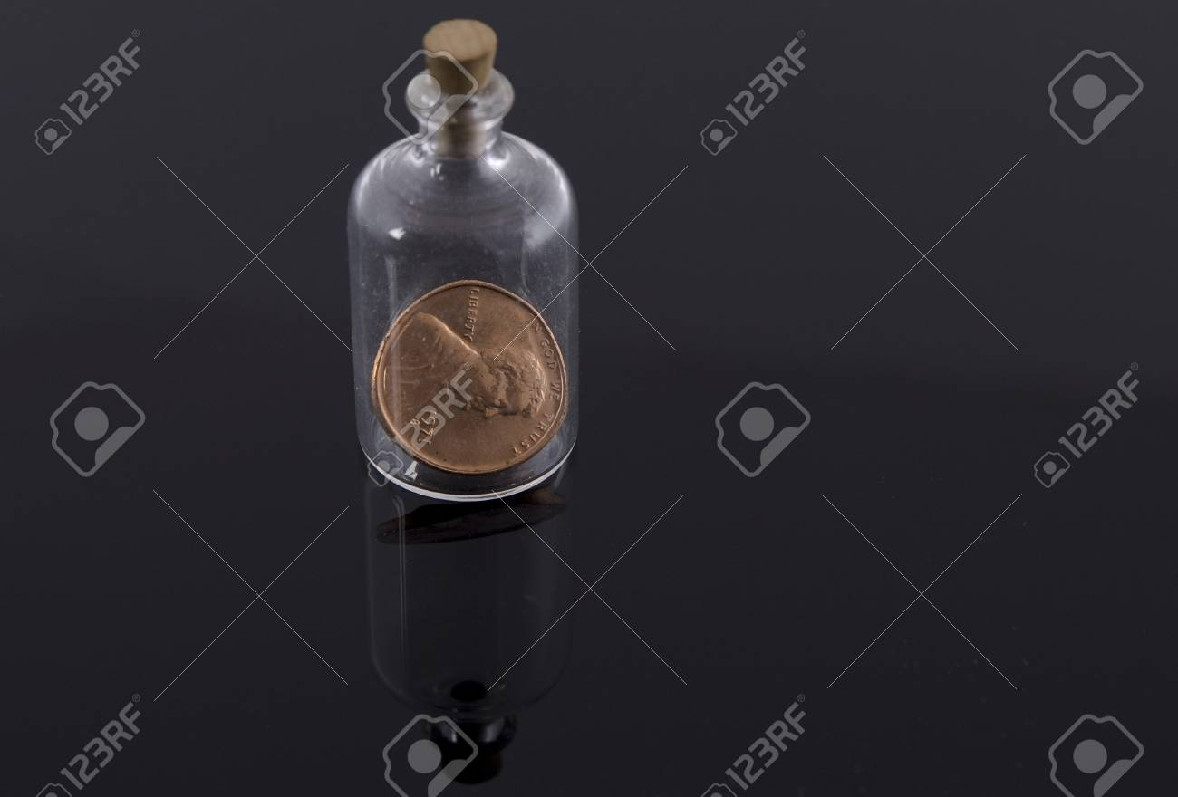One penny in corked bottle Stock Photo - 14860765