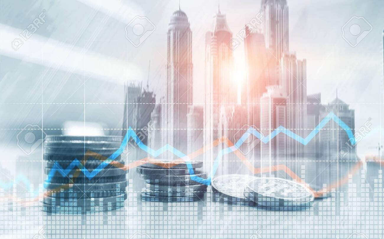 Double exposure of city and rows of coins with stock and financial graph on virtual screen. Business Investment concept. - 120219971