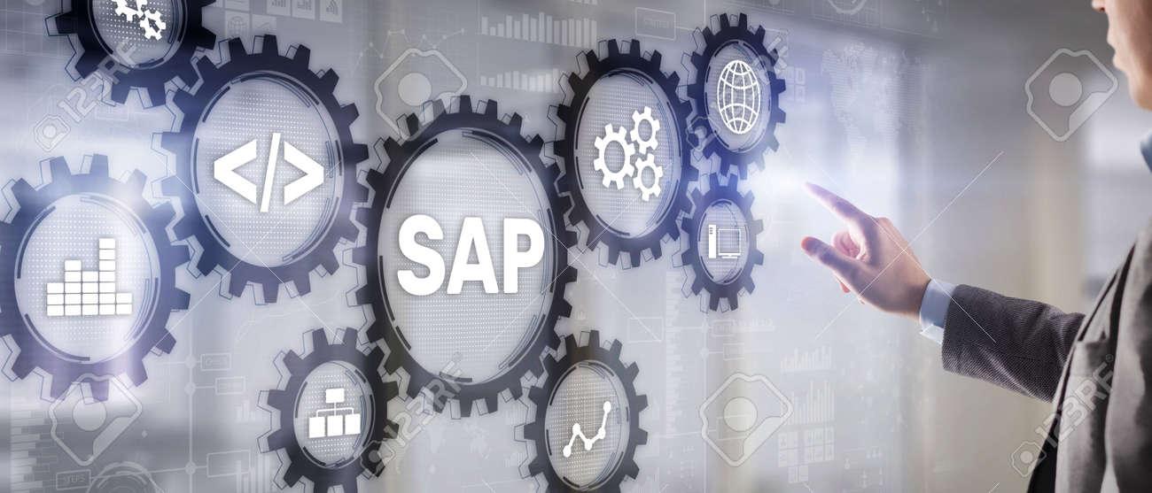 SAP System Software Automation concept. Businessman presses virtual button SAP - 169591275