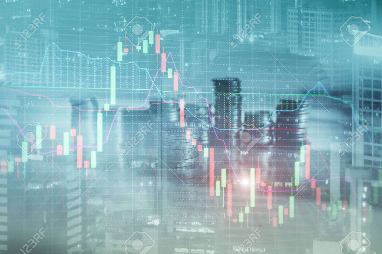 Research and analytics concept. Stacks of coins against the backdrop of a modern city. - 169591443