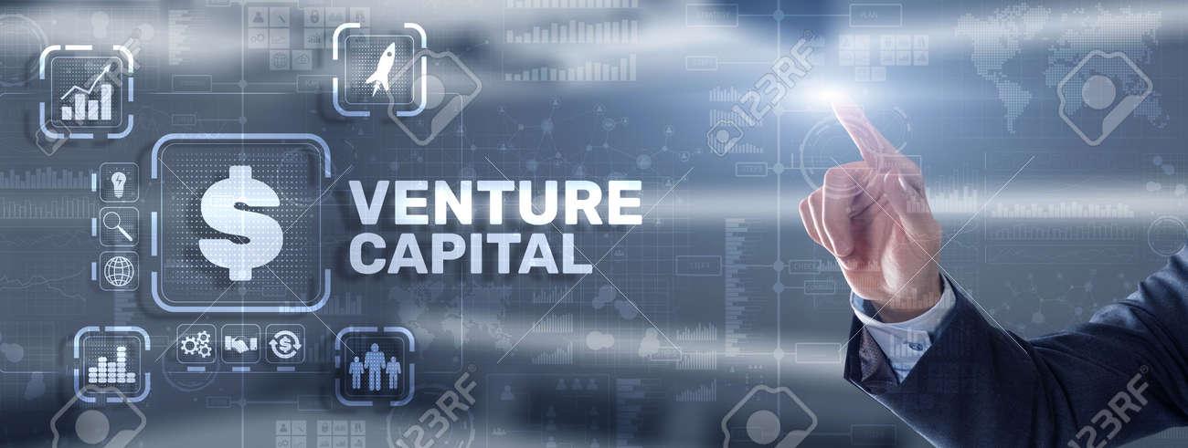 Venture capital. Investor capital. Businessman pressing virtual screen inscription - 170220172