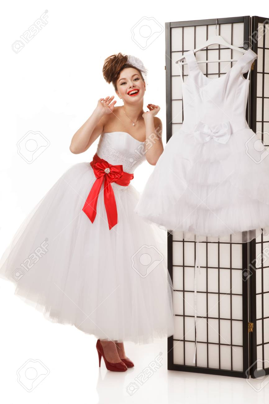 Pin-up Bride Standing Near Folding Screen With Another Wedding ...