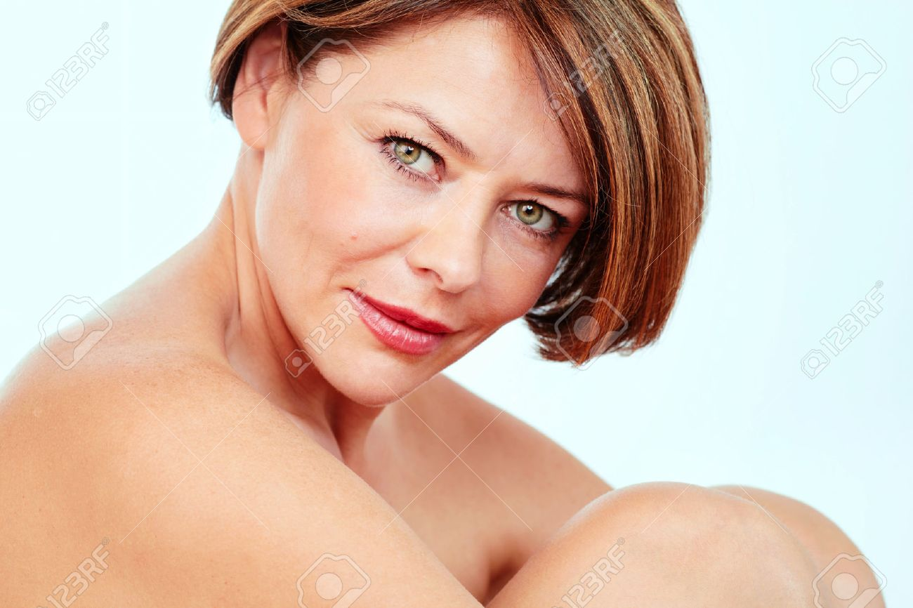 close up portrait of beautiful nude mature woman hugging her.. stock