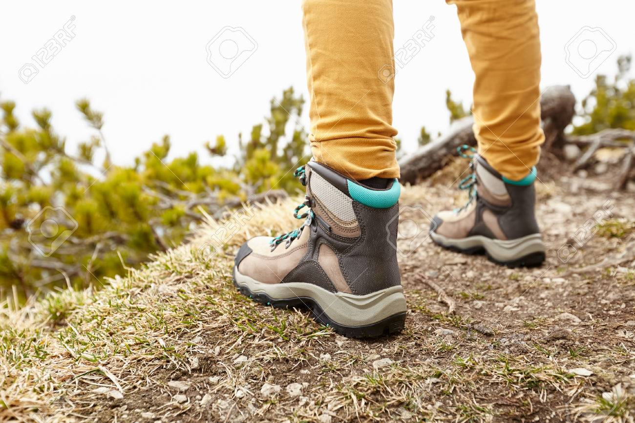 Back View Close Up Of Woman Wearing Yellow Pants And Hiking Boots