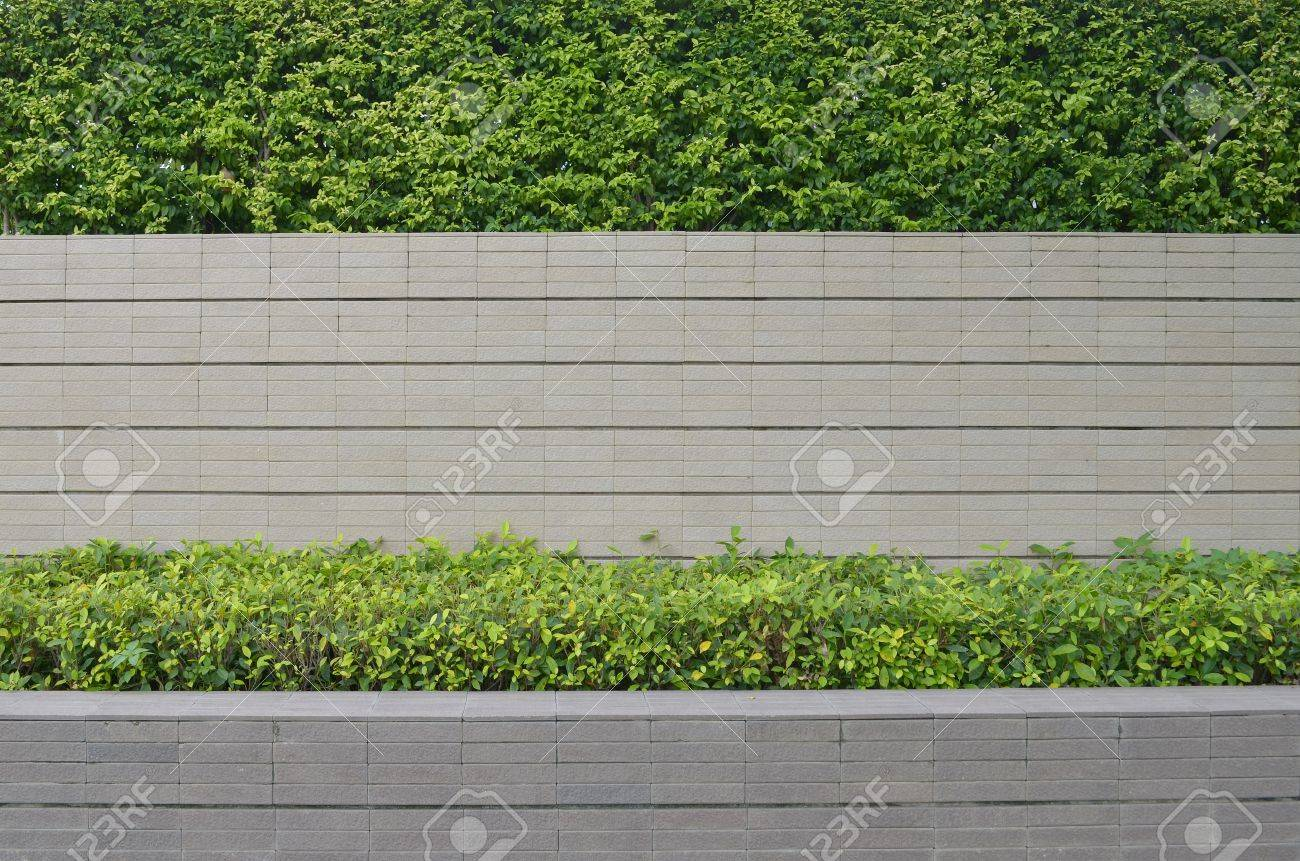 Decorative Garden On A Brick Fence Stock Photo, Picture And Royalty ...