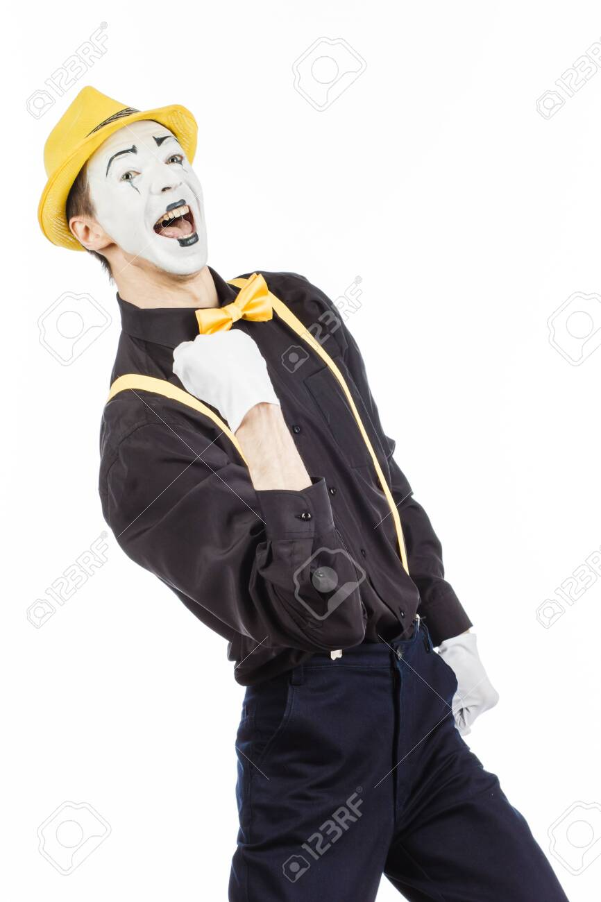 A happy young man, an actor, pantomime, rejoices in success. On a white background. - 123585030