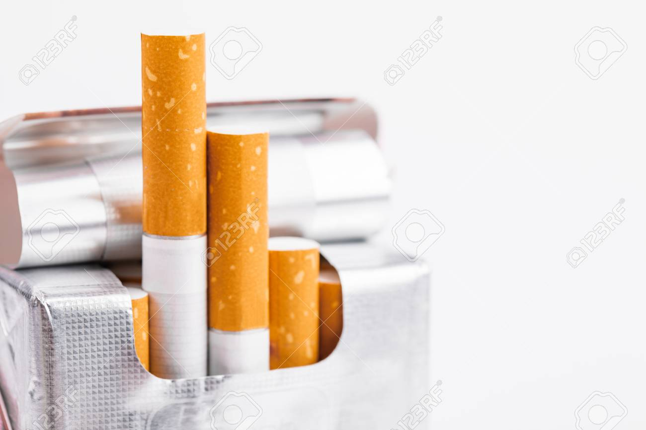 Cigarettes in a pack closeup on white background. Smoking tobacco. Bad habit. - 120740643