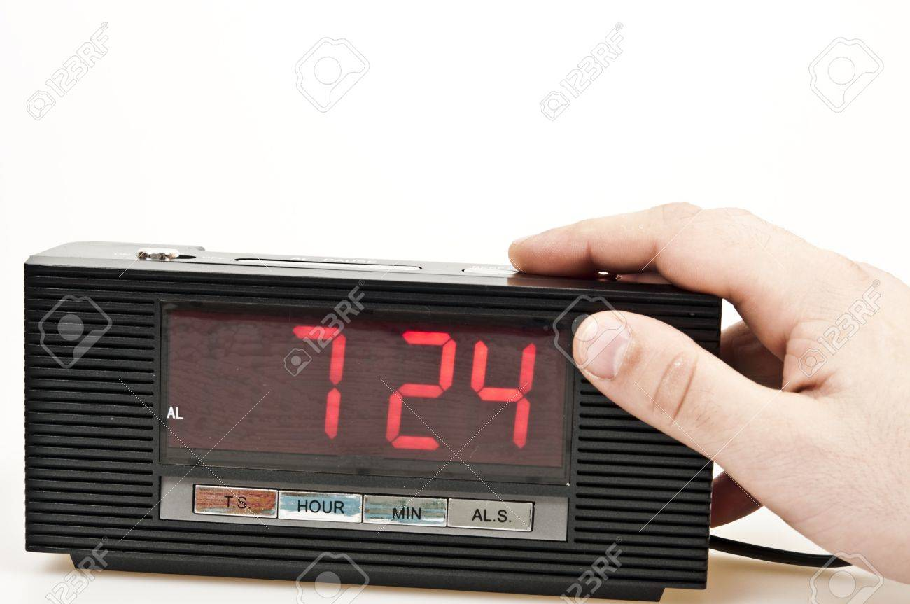 Male hand stopping alarm clock Stock Photo - 8766182