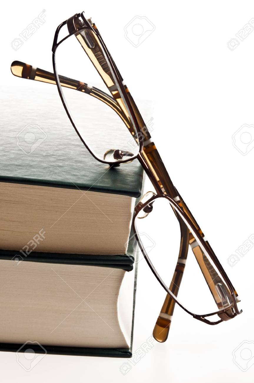 Isolated green books and eyeglasses Stock Photo - 8767041