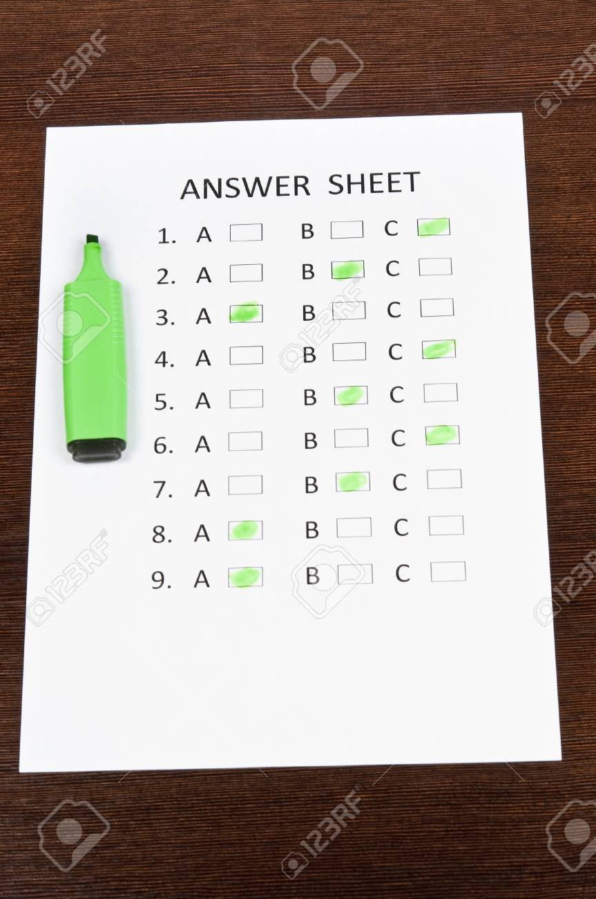 Answer sheet and green marker Stock Photo - 9199852