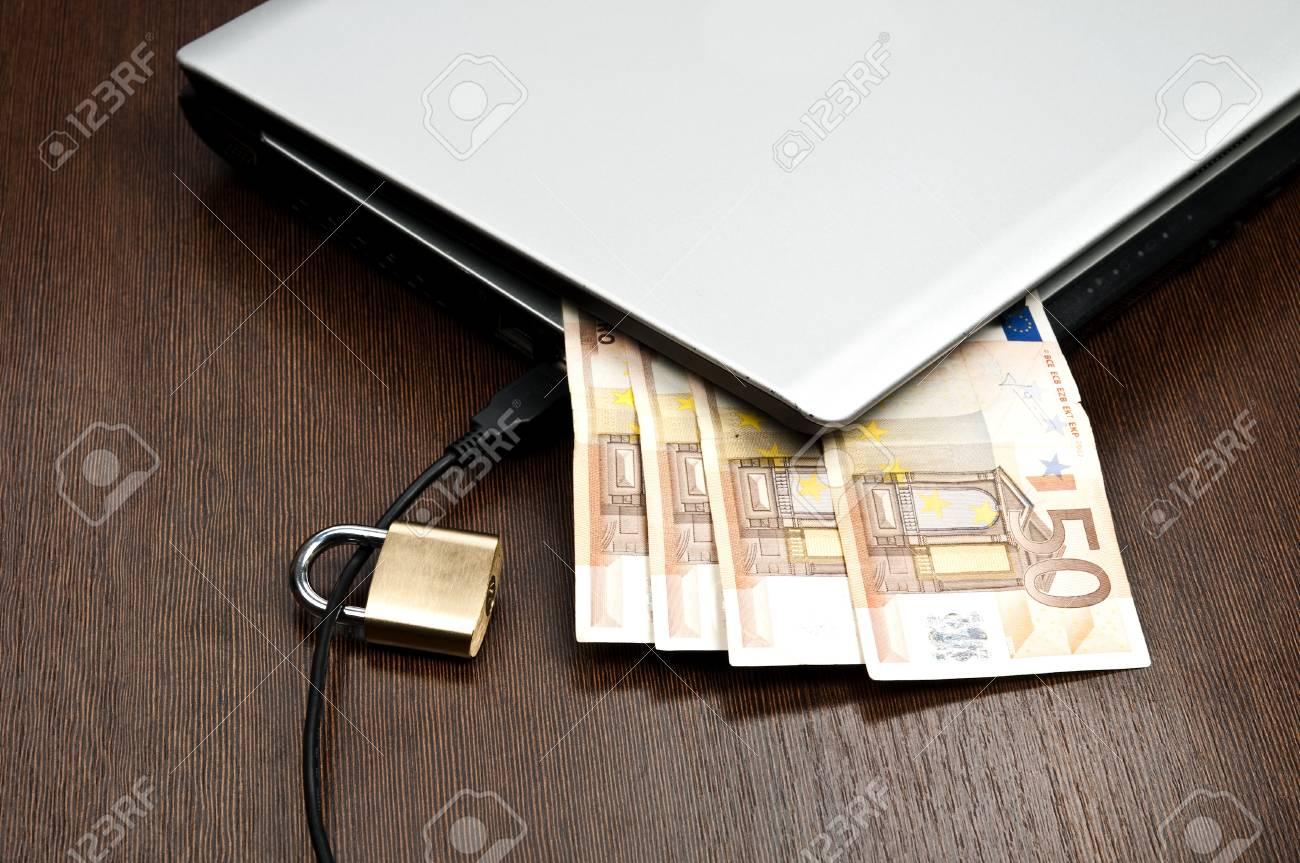 Closeup to laptop and euro banknotes Stock Photo - 9252663
