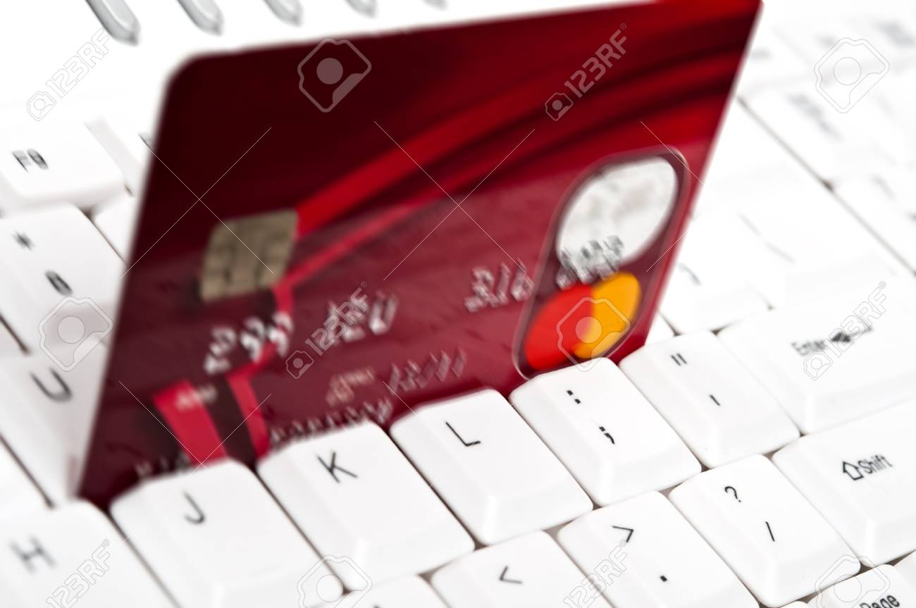 Credit card on an white keyboard Stock Photo - 9252751