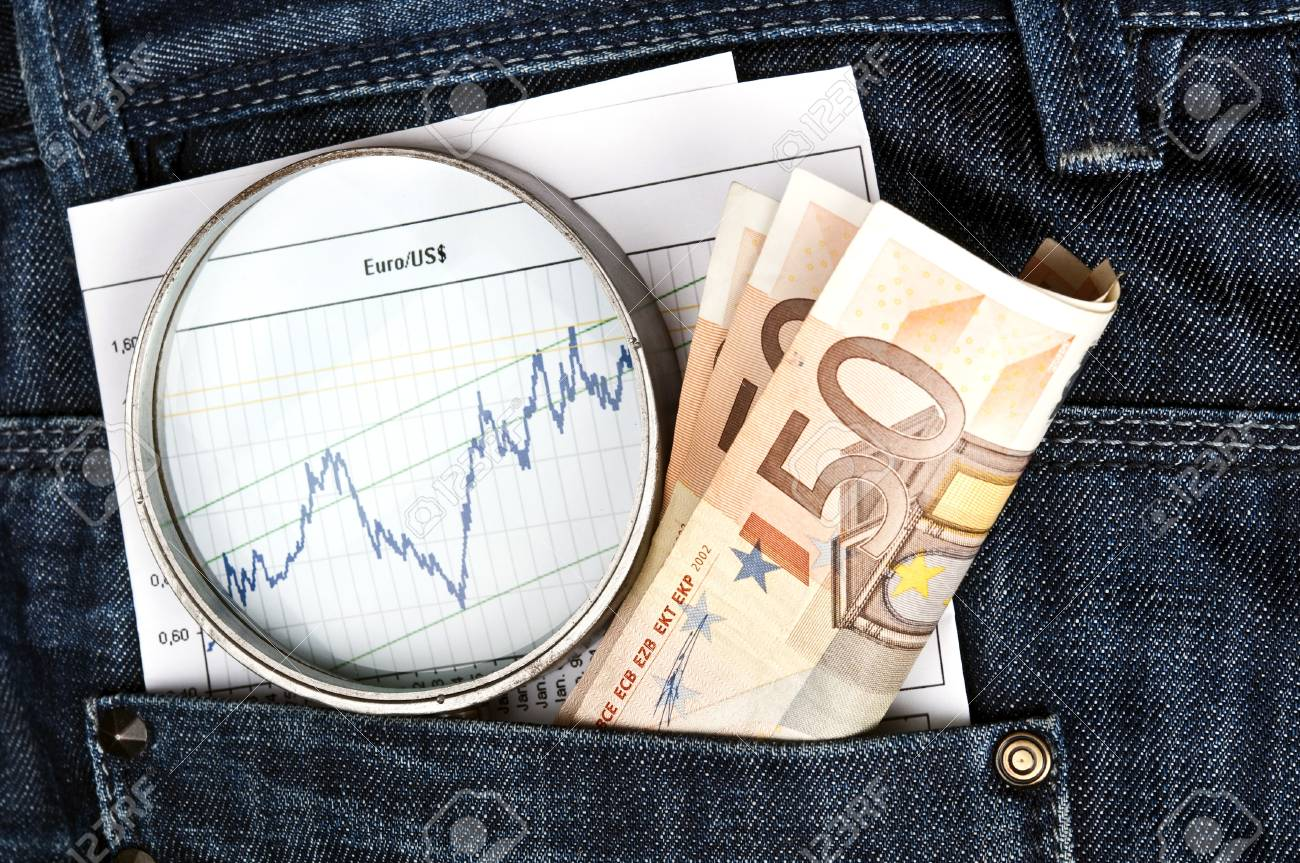 Jeans pocket with magnifying glass and exchange graph Stock Photo - 9344596