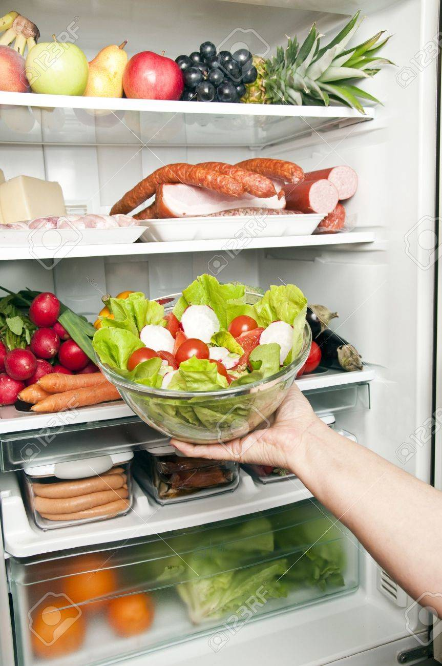 Refrigerator close up with salad Stock Photo - 9346380