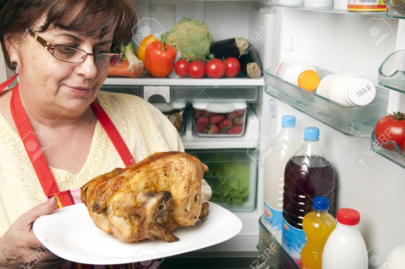 Refrigerator close up with mature woman Stock Photo - 9345751