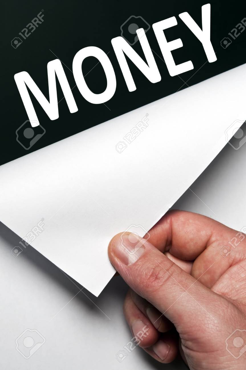 Money word discovered by male hand Stock Photo - 9627500