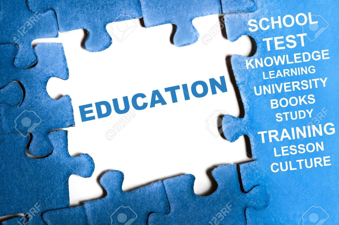 Education blue puzzle pieces assembled Stock Photo - 9628576