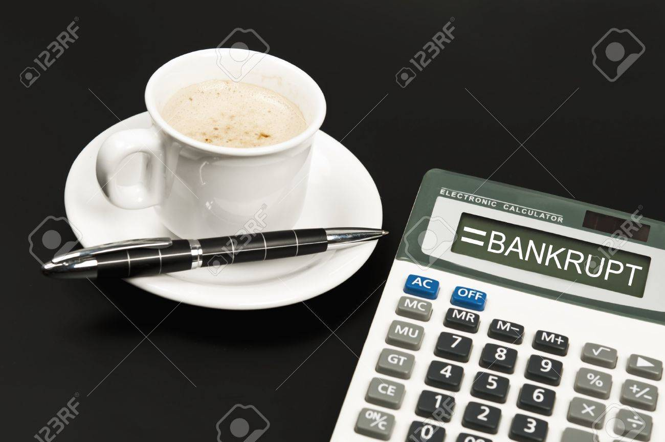 Bankrupt result on electronic calculator and coffee Stock Photo - 10063261