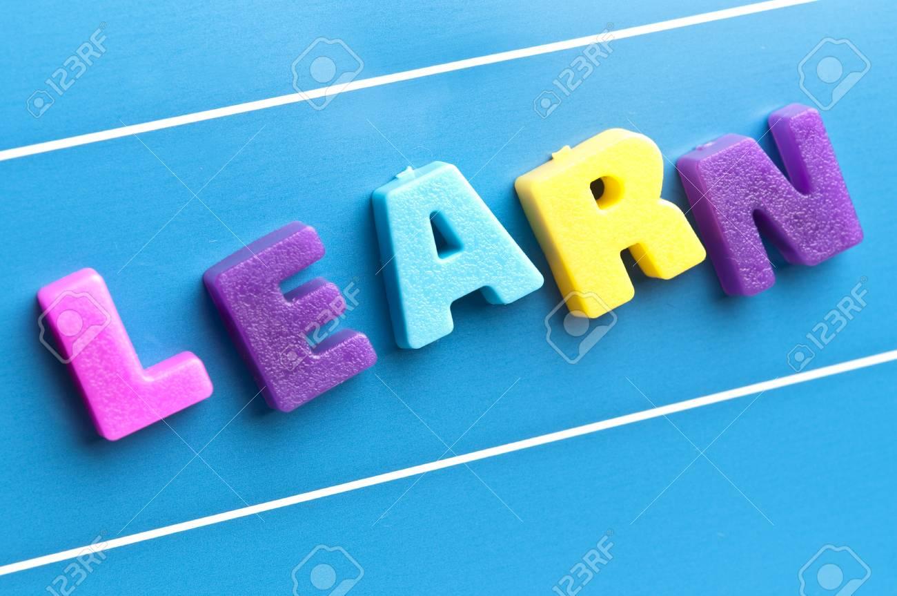 Learn word on blue board Stock Photo - 11529134