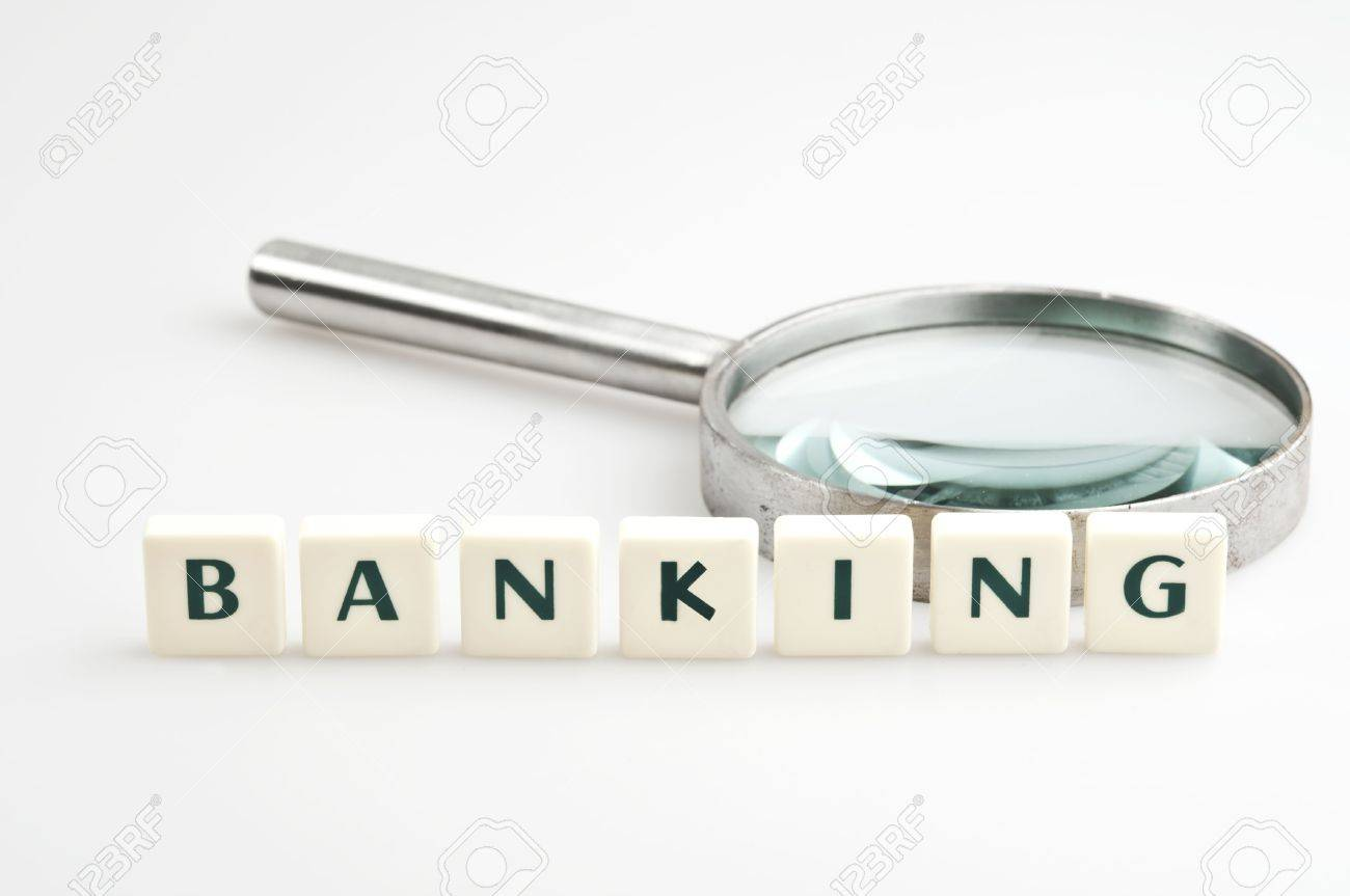 Banking word and magnifying glass Stock Photo - 11528825