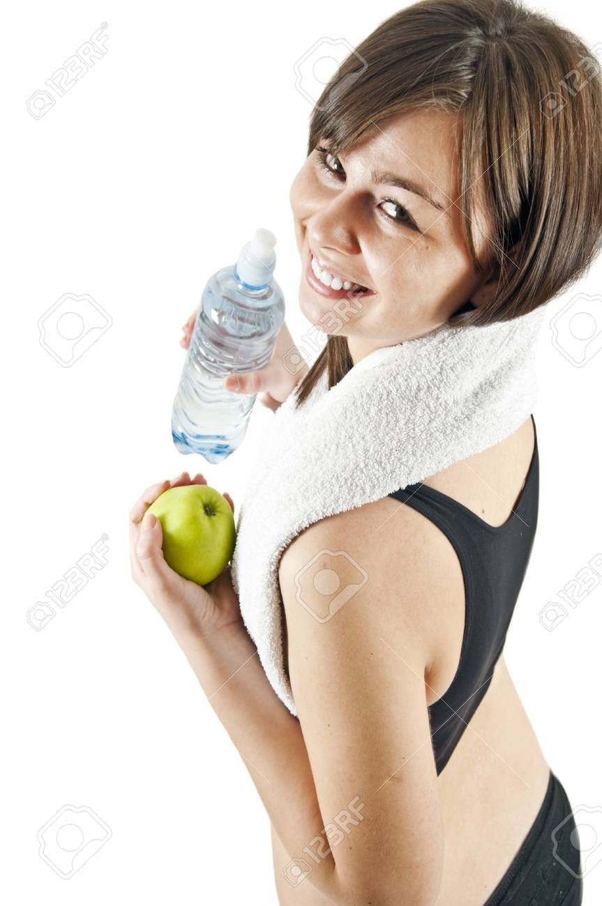 Isolated woman with apple after workout Stock Photo - 12904972