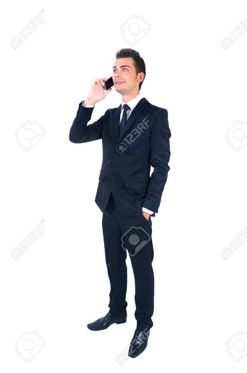 Isolated young business man with phone Stock Photo - 14664460