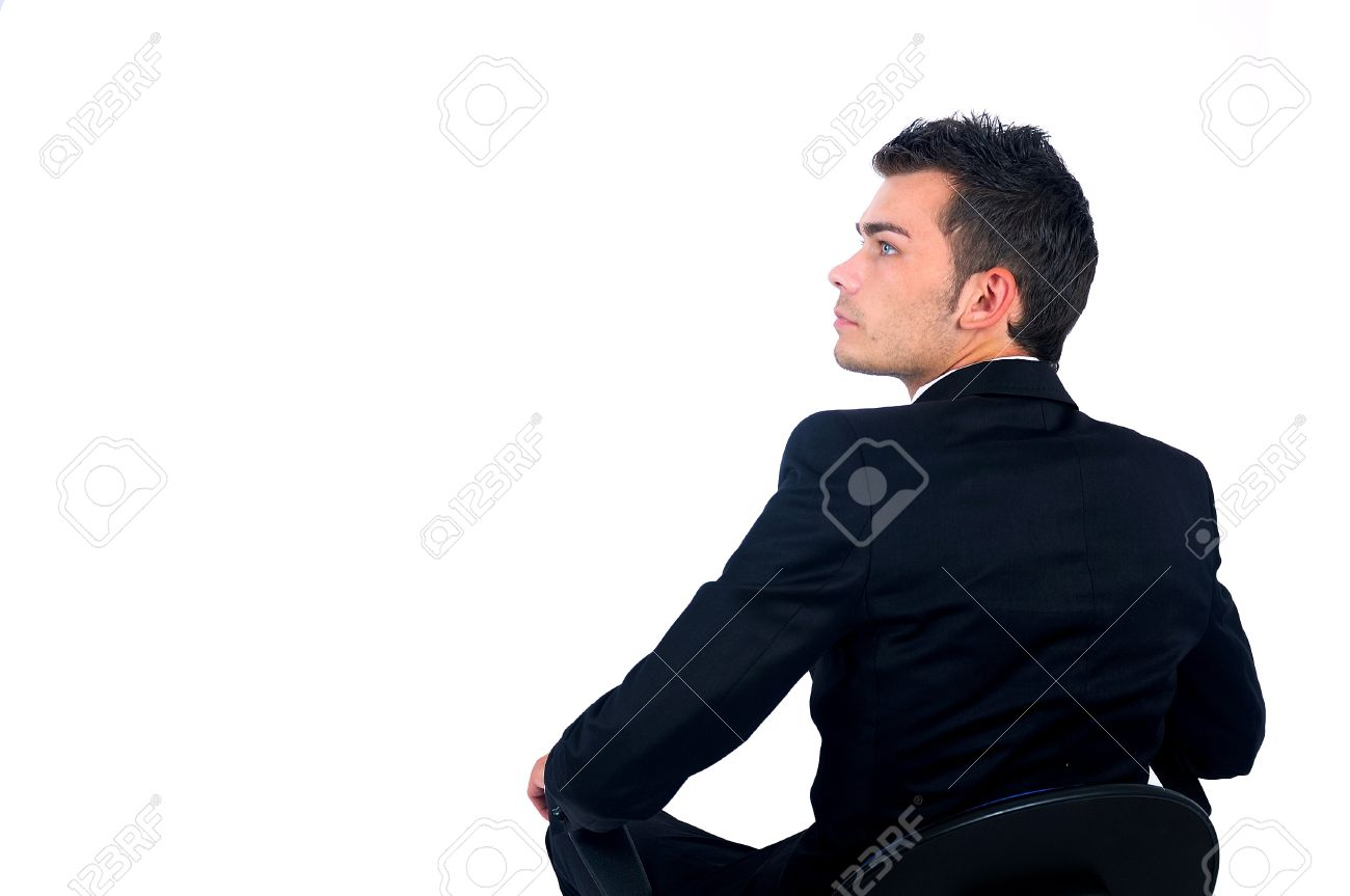 Isolated young business man sitting on chair Stock Photo - 14664685