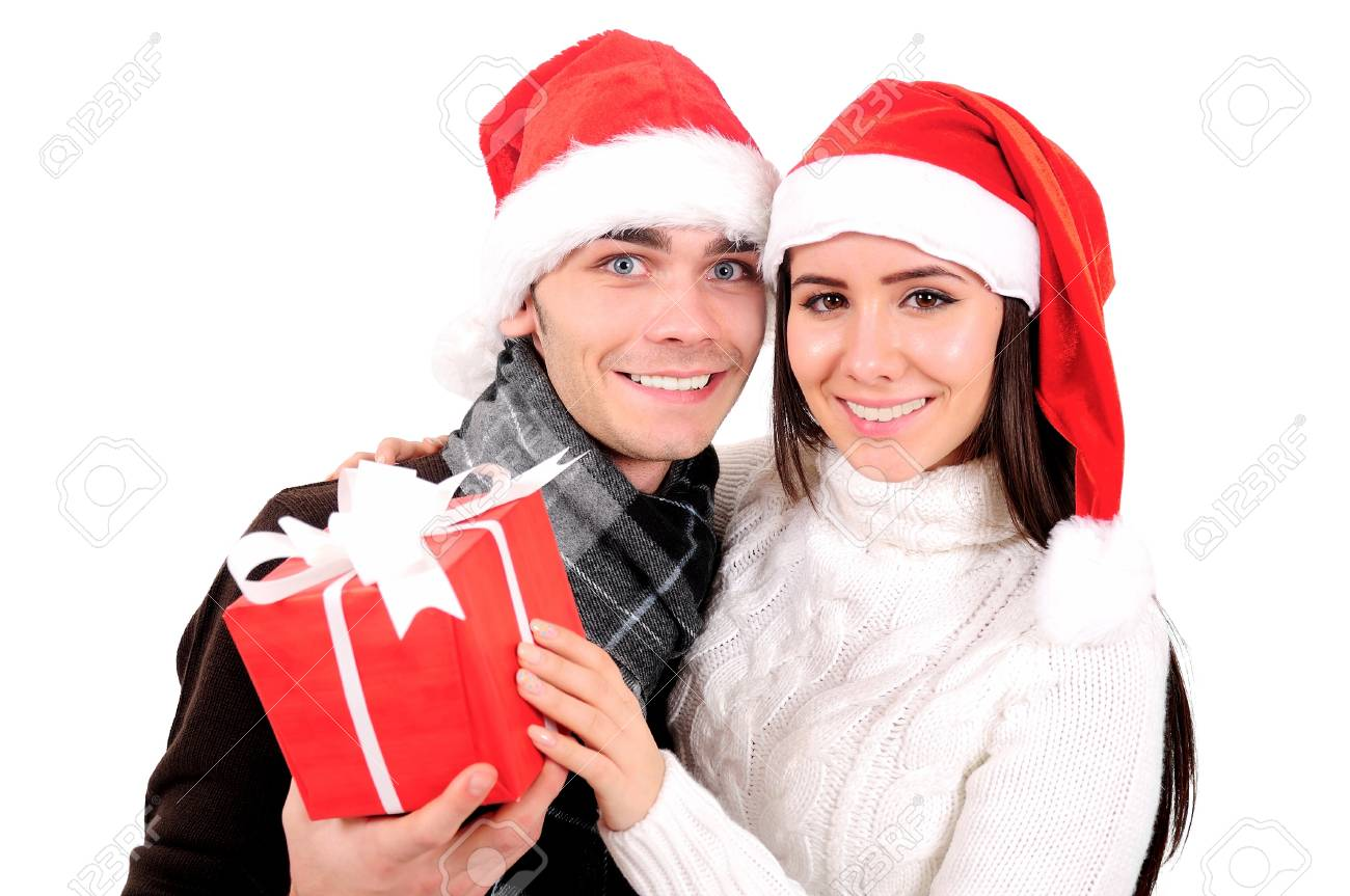 Isolated Young Christmas Couple Holding Gift Stock Photo - 16599049