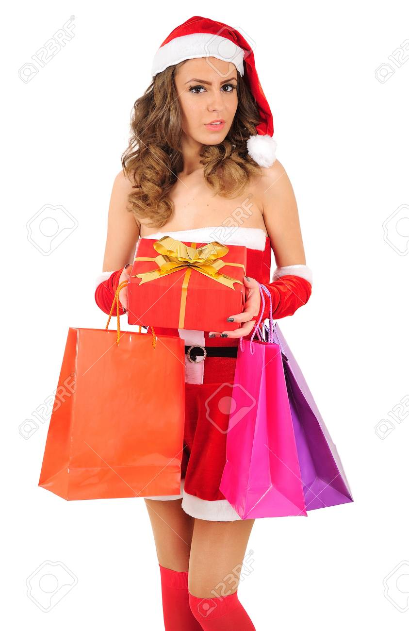 Isolated young christmas woman with shopping bag Stock Photo - 16641202