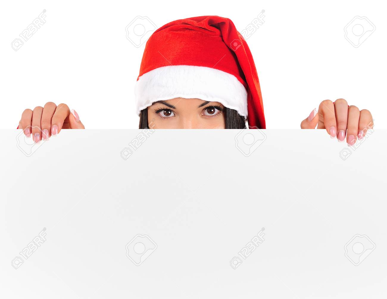 Isolated young brunette christmas girl showing paper Stock Photo - 16764024