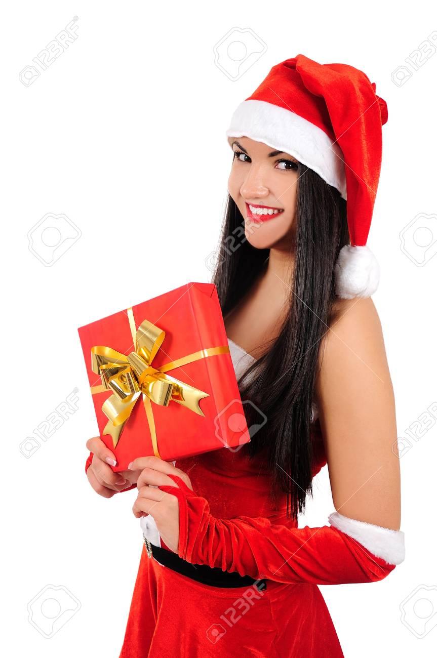 Isolated young brunette christmas girl holding gift Stock Photo - 16764112