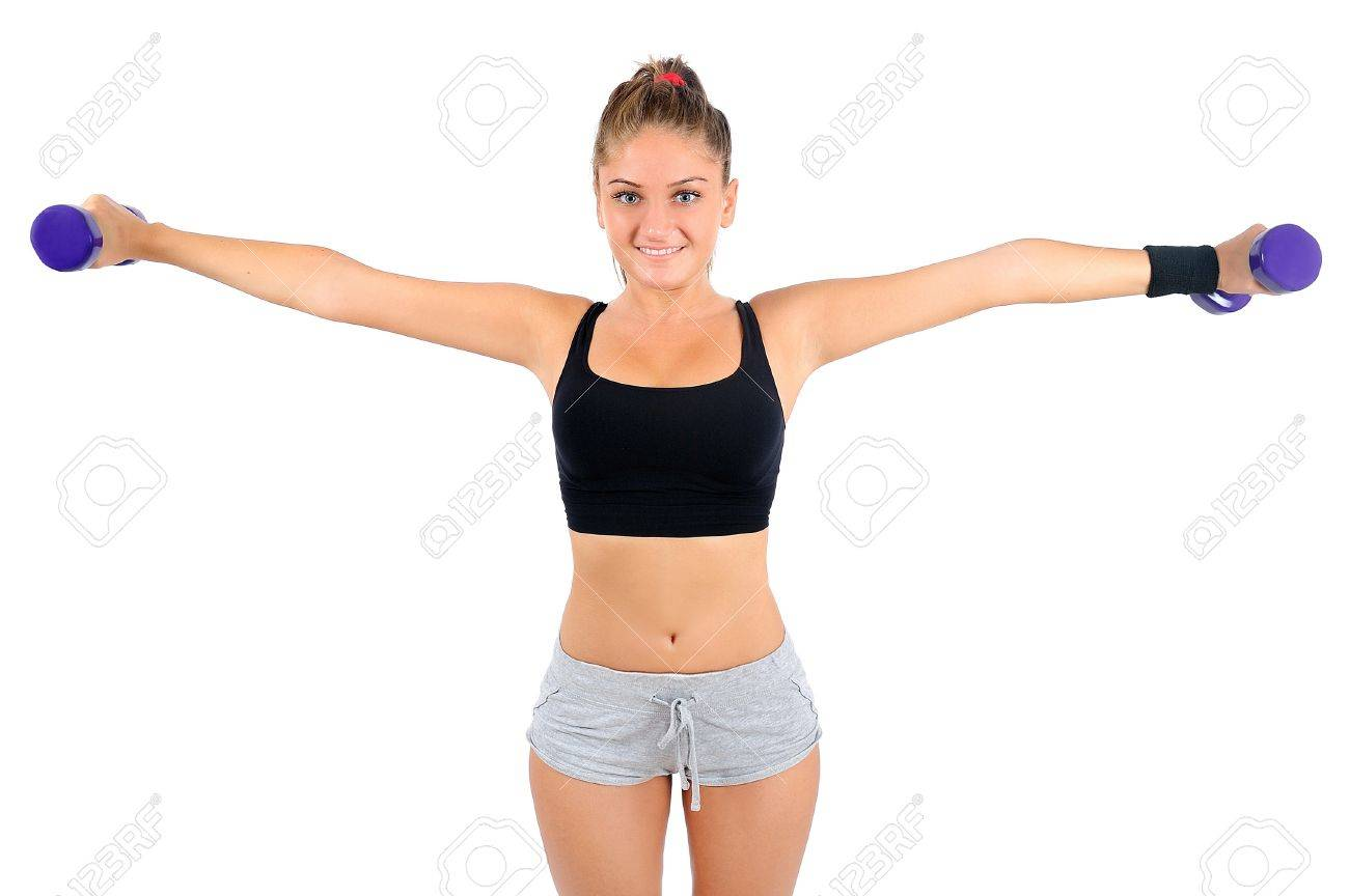 Isolated young fitness woman with dumbbell Stock Photo - 16862633