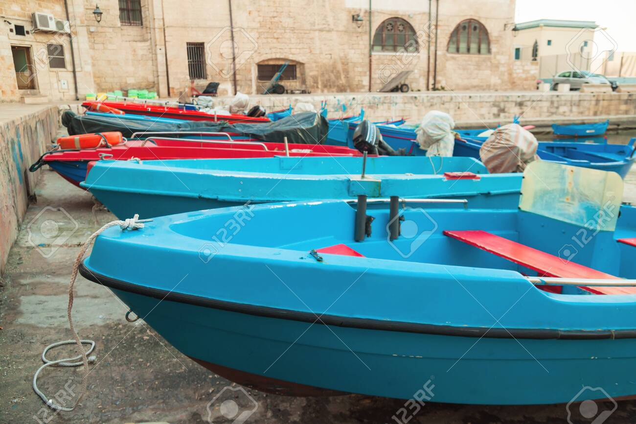 Superb Old Blue Fishing Boats With Red Wooden Benches Rest In Port In Evergreenethics Interior Chair Design Evergreenethicsorg