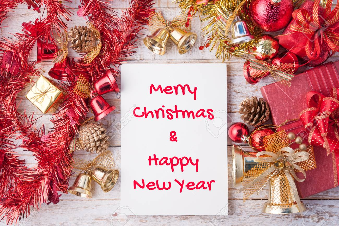 Merry Christmas And Happy New Year Word On Notebook And Christmas