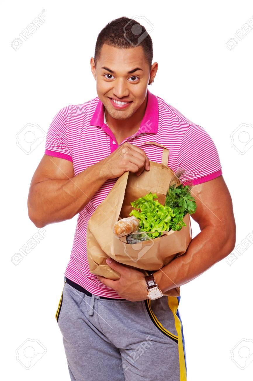 Portrait of handsome man posing in studio with food Stock Photo - 17719569