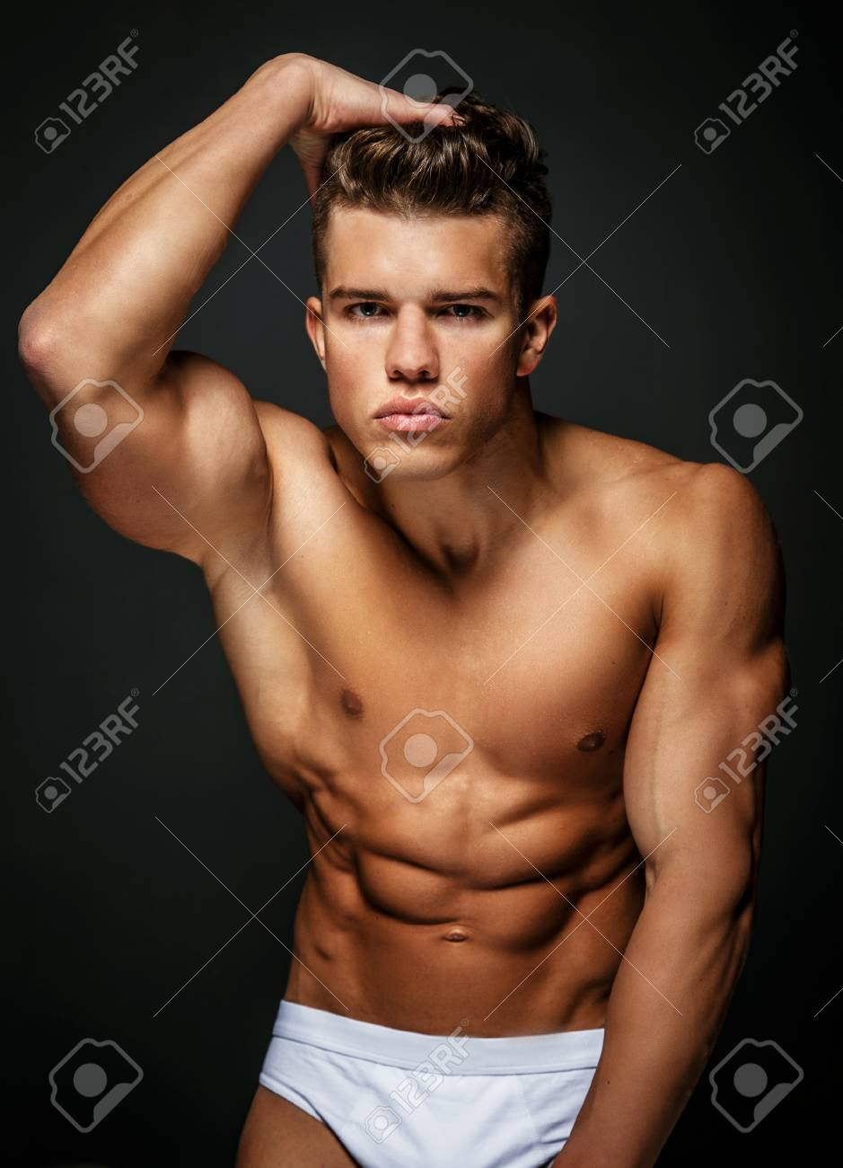 Portrait Of Awesome Male Model With Naked Muscular Body Isolated