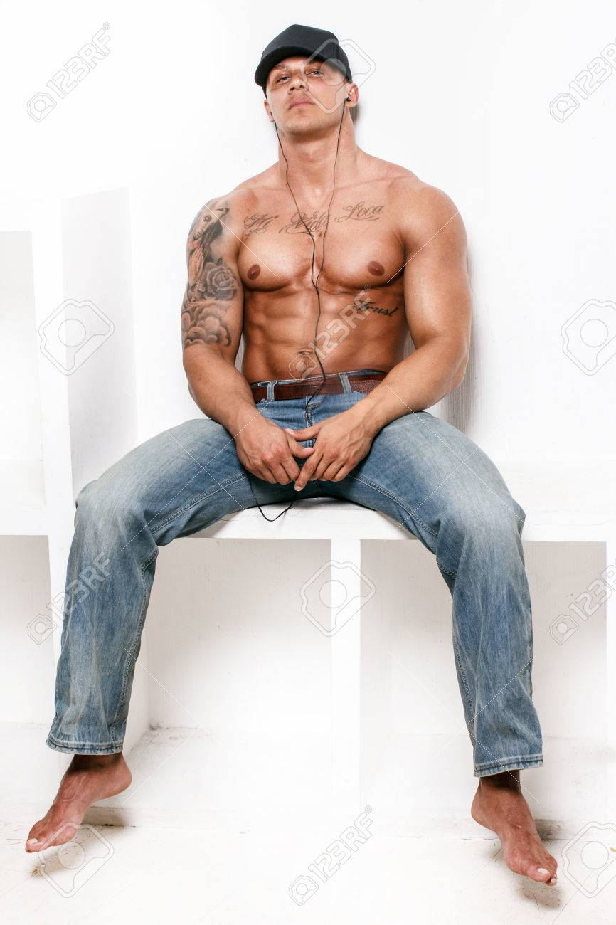 9db71bed Awesome muscular guy in blue jeans and a cap on white background Stock  Photo - 40247131