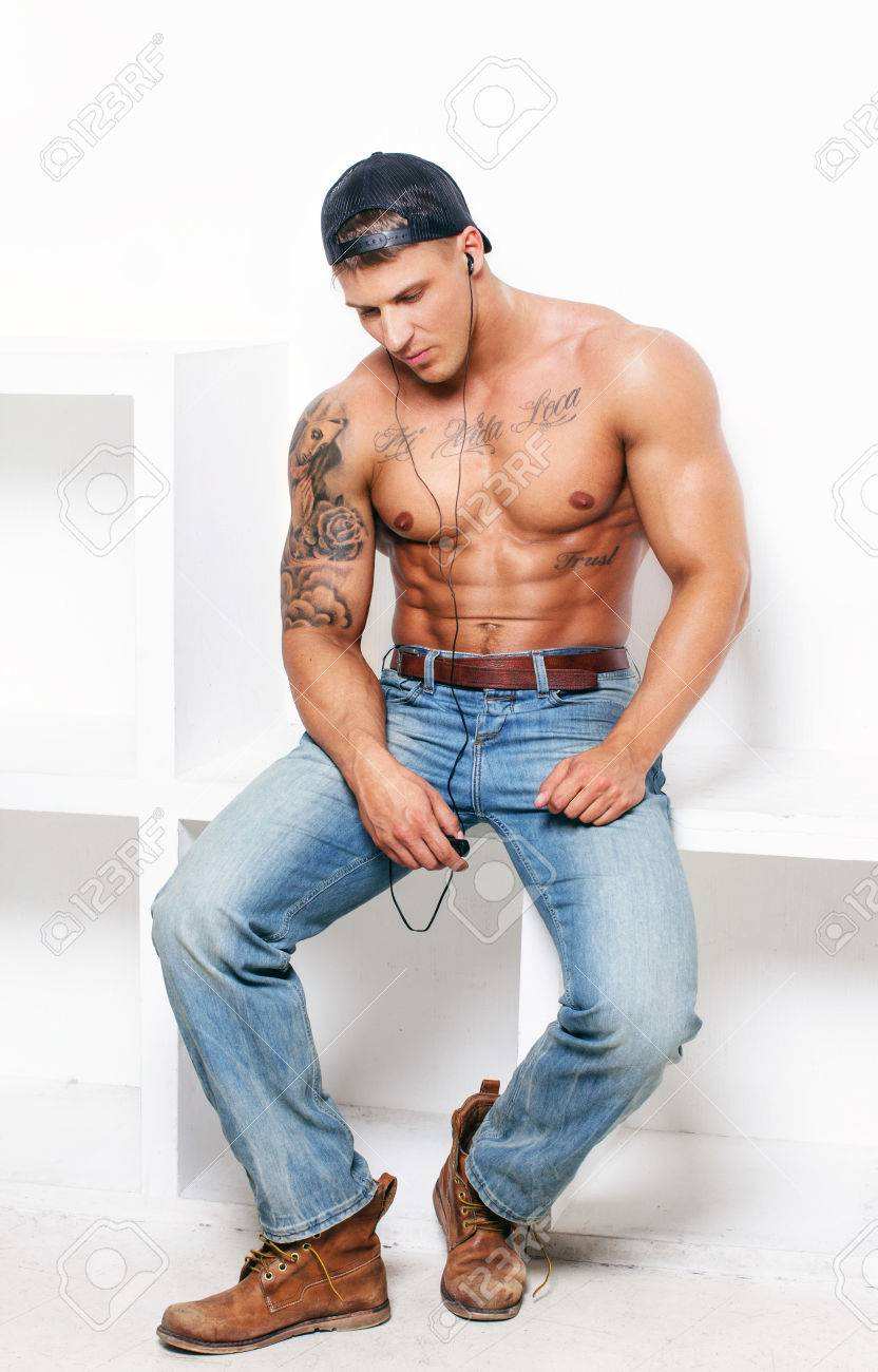 e76b5fc9 Muscular Guy With Tattooes In Blue Jeans Stock Photo, Picture And ...