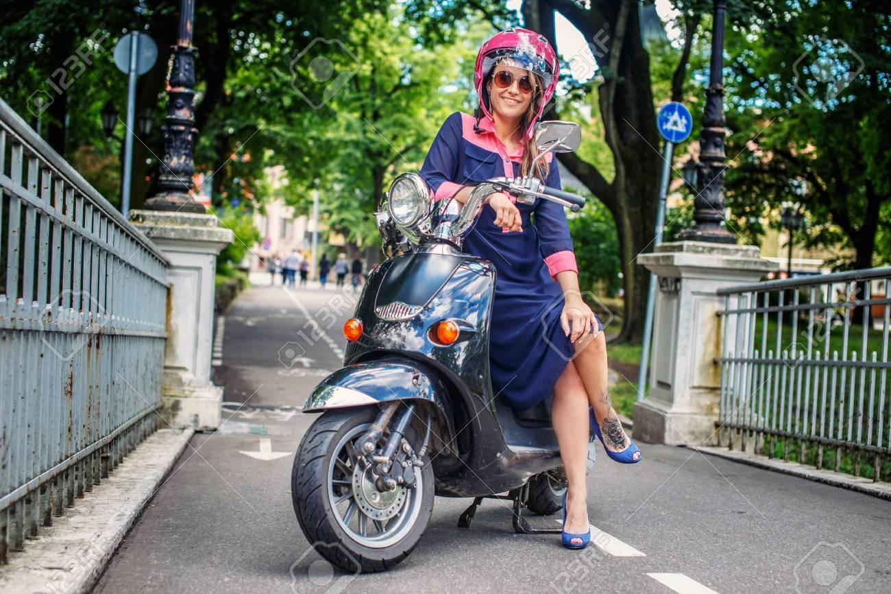 Fashin girl sitting on street scooter. - 44634620