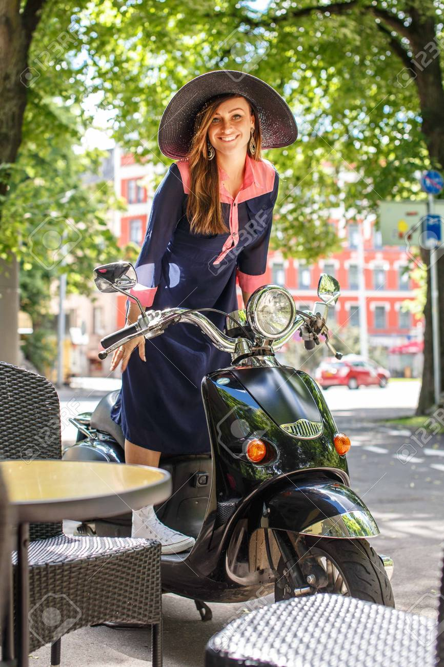 Fashin girl sitting on street scooter. - 44634735