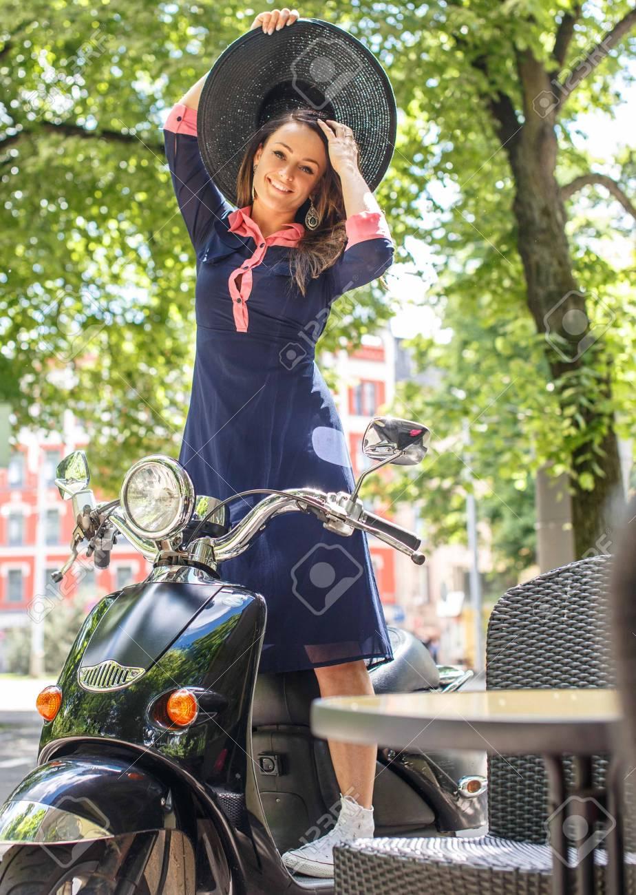 Fashin girl sitting on street scooter. - 44717168