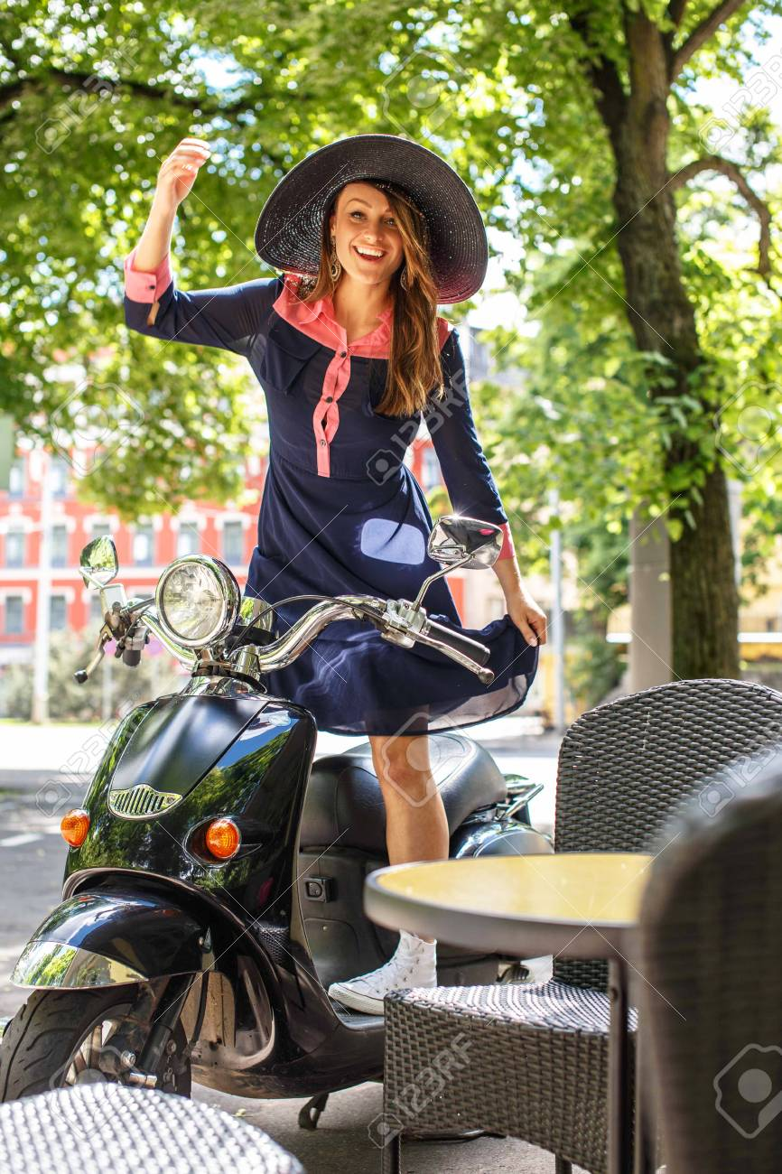Fashin girl sitting on street scooter. - 44904830
