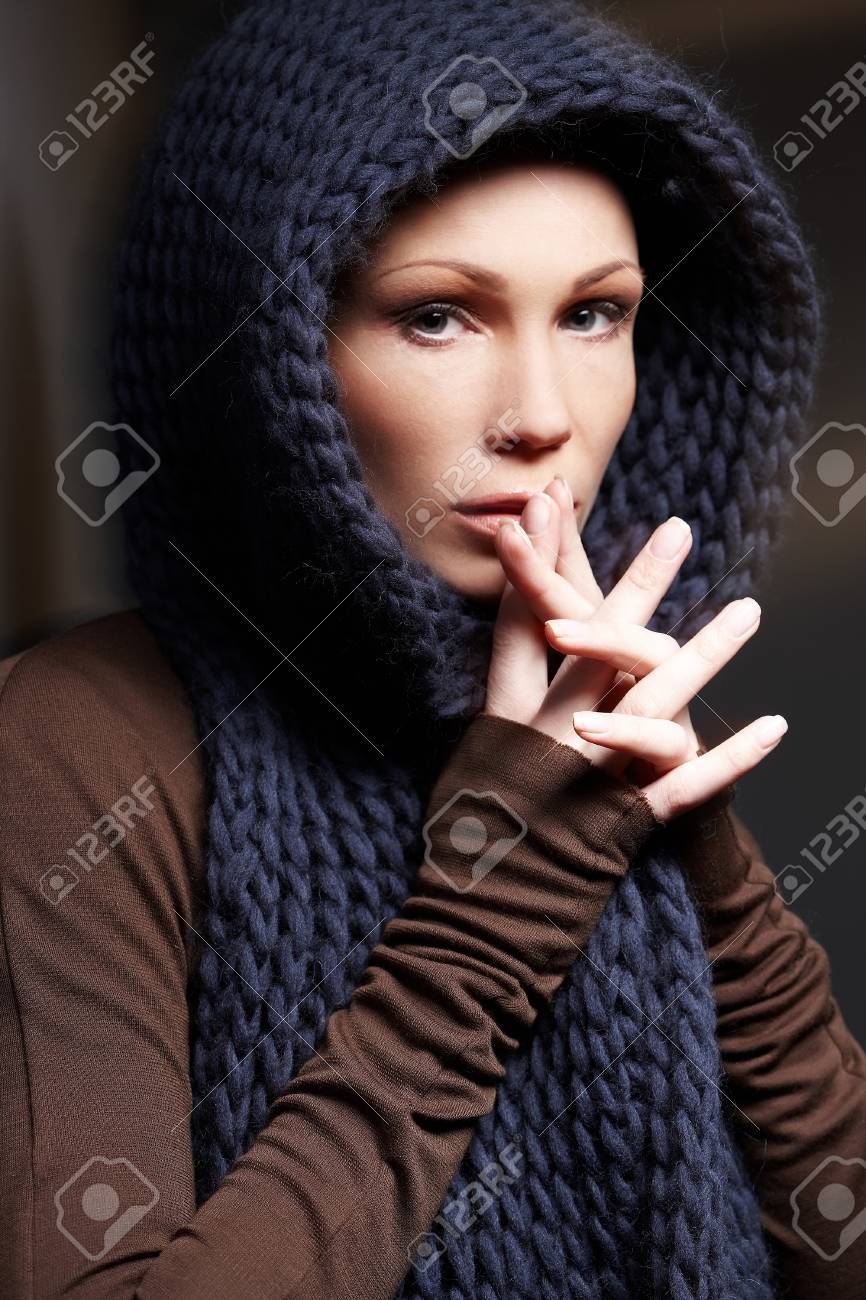 df715bab60 Portrait of middle age woman in brown sweater with blue scarf. Stock Photo  - 45112973
