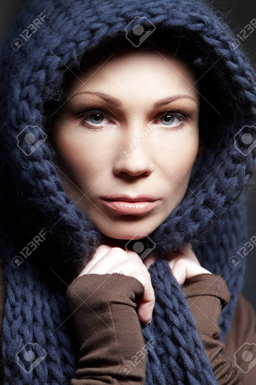 9d00f794ef Portrait of middle age woman in brown sweater with blue scarf. Stock Photo  - 45119195