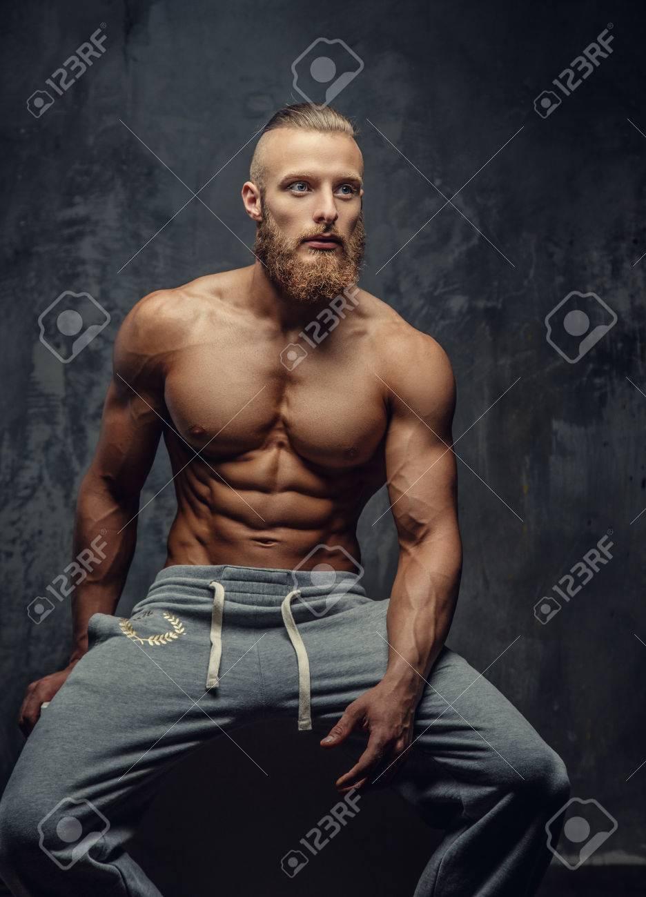 Shirtless Muscular Bodybuilder With Beard Stock Photo 81643250