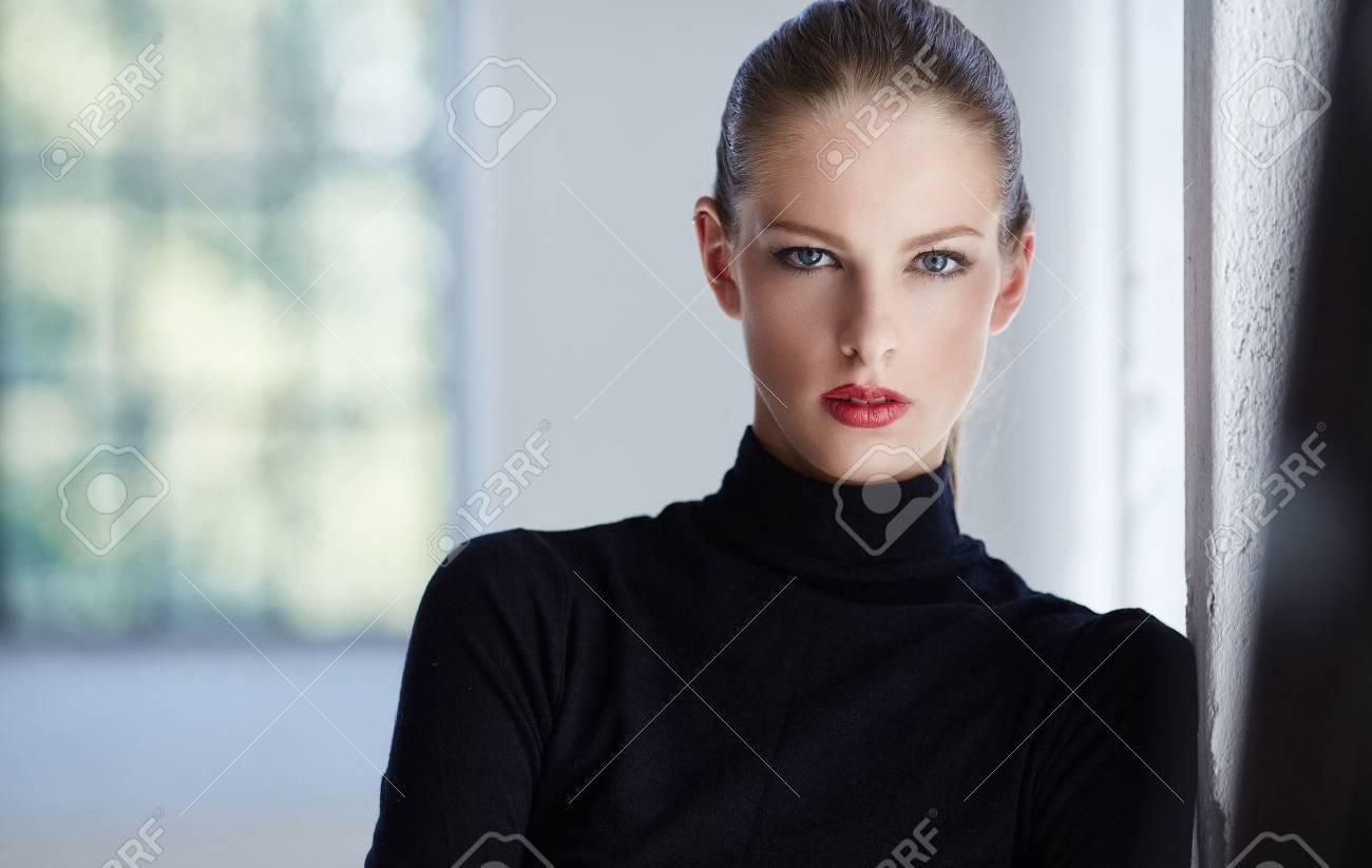 Portrait of luxury brunette woman in black sweater. - 45604958