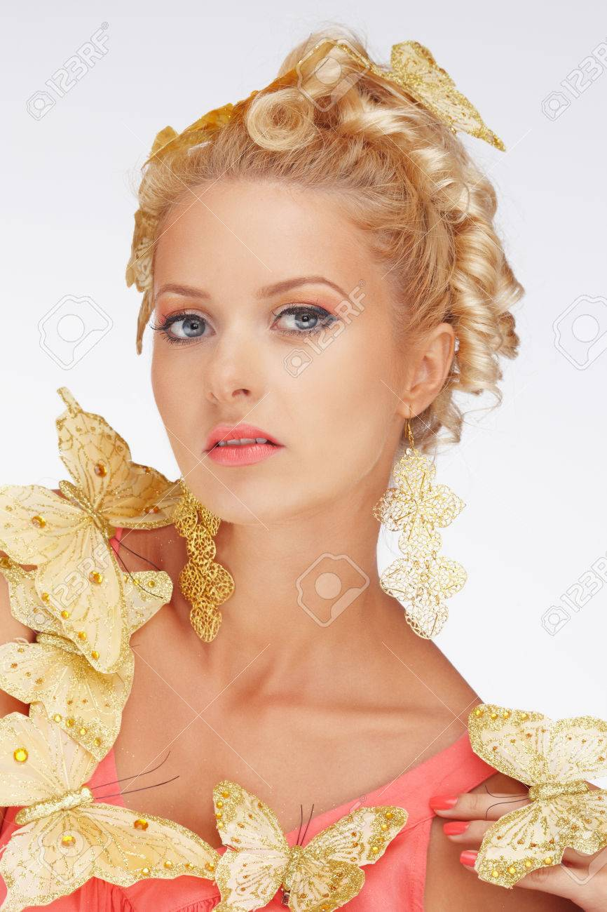 Portrait of blond woman with butterfly isolated on a white background.  Stock Photo - 57099962 74a458986